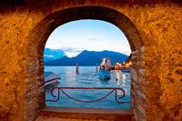 Town of Varenna lakefront evening view through stone window evening view, Lake Como