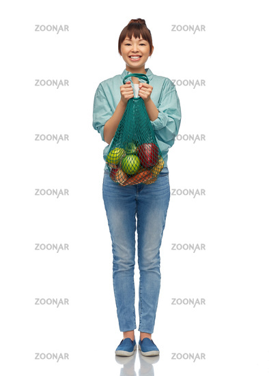 happy asian woman with food in reusable string bag