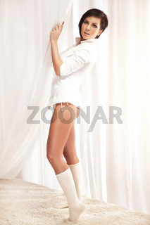 Beautiful woman wearing white shirt and knee-length socks