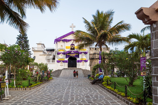 Village church decorated for the easter holy week in purple in San Pedro la Laguna, Guatemala