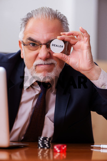 Businessman in the office playing games