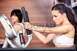 Women in gym center
