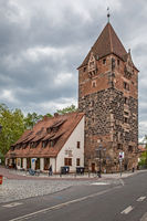 Street in the old town of Nuremberg with medieval tower
