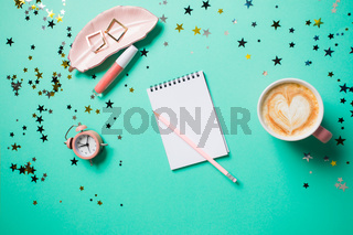 Top view with jewelery, clock, lipgloss and cappuccion cup