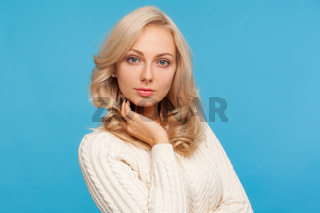 Portrait of blonde woman on blue background.