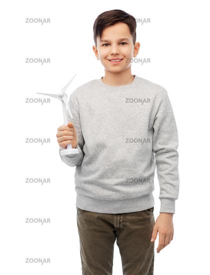 smiling boy with toy wind turbine