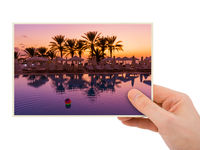 Hand and Swimming pool on Cyprus island at sunset (my photo)