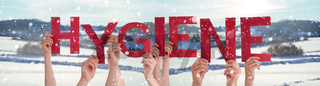 People Hands Holding Word Hygiene, Snowy Winter Background