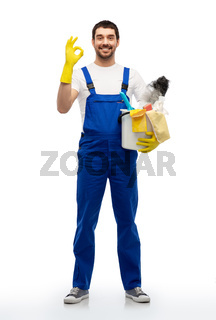 male cleaner with cleaning supplies showing ok