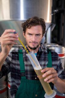Worker testing beer