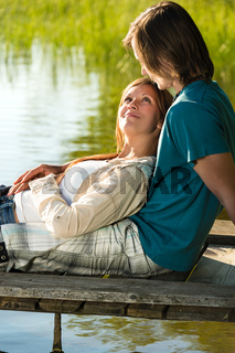 Romantic couple lounging on the pier