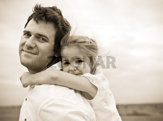 Happy young father with little daughter