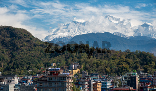 Pokhara cityscape with the Annapurna mountain range covered in snow at central Nepal, Asia