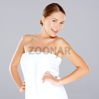 Smiling woman posing in a white towel