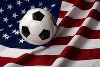 Football soccer ball over American flag