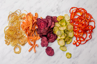 Dehydrated vegetables heap isolated on white as a snack for vegetarians