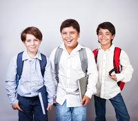 Three happy schoolboys