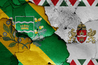 flags of District XVI. and Budapest painted on cracked wall