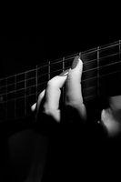 fingers on strings
