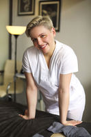 Smiling masseuse smiling in spa salon