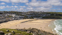 ST IVES, CORNWALL, UK - MAY 13 : View of Porthmeor beach at St Ives, Cornwall on May 13, 2021. Unidentified people