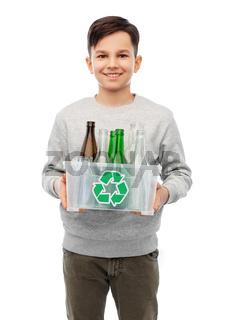 smiling boy sorting glass waste