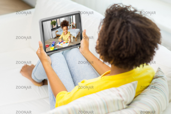 mother has video call with daughter on tablet pc