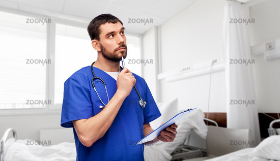 doctor or male nurse with clipboard