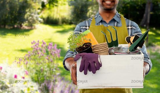 indian gardener or farmer with box of garden tools