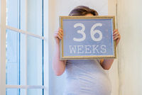 36 weeks of pregnancy sign in woman hands