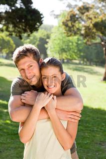 Man hugging his beautiful wife