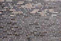Neue graue Backsteinwand