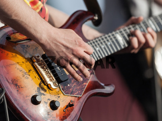 Human hand holding guitar music instrument