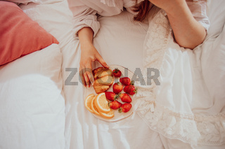 Happy woman celebrating goodness with simple pleasures