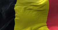 Close-up view of the national flag of Belgium waving in the wind. Democracy and independence.