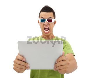 Surprised Young man in 3D glasses and watching the tablet pc