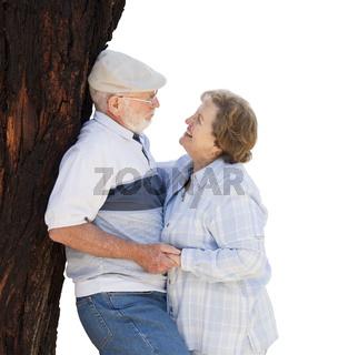 Happy Senior Couple Leaning Against Tree on White