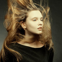 Beautiful girl with a flying hair