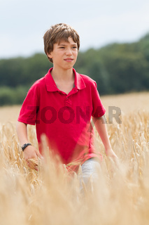 child in a wheat field