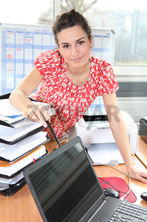 Woman standing at her desk