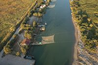 Awesome Drone view of fishing huts in the river