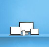 Computer, laptop, mobile phone and digital tablet pc. blue shelf background