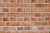 Saubere orangefarbene Backsteinmauer
