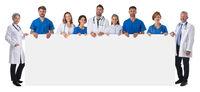 Medical team holding blank billboard