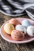 Colorful chocolate easter eggs. Sweet candy eggs on wooden table.