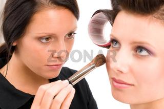 Make-up artist woman fashion model apply powder
