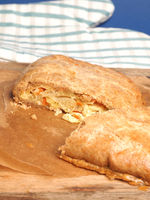 Vegetable pate from the oven on a rustic wooden table, organic bakery products