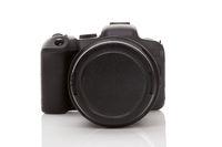 Digital mirrorless full frame camera isolated on white background