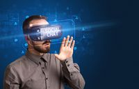 Businessman looking through Virtual Reality glasses, social media concept