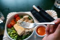 Healthy breakfast bowl with porridge and fresh vegetable salad
